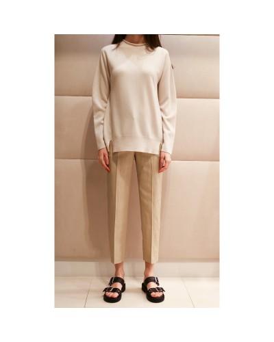 Kremowy sweter damski